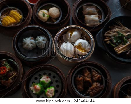 N Selective Of The Steamed Stuff Bun,chinese Food ,dimsum In Bamboo Basket.put On Table ,