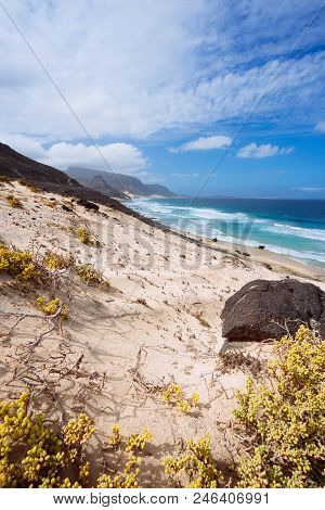 Stunning Desolate Landscape Of Sand Dunes And Desert Plants Of Atlantic Coastline With Ocean Waves.
