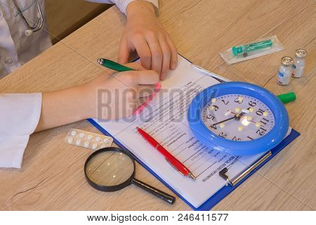 Female Medicine Doctor Hands Filling Patient Medical Form. Doctor Concept. Physician Working With Pa