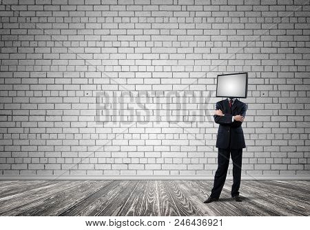 Businessman In Suit With Tv Instead Of Head Keeping Arms Crossed While Standing Inside Empty Room Wi