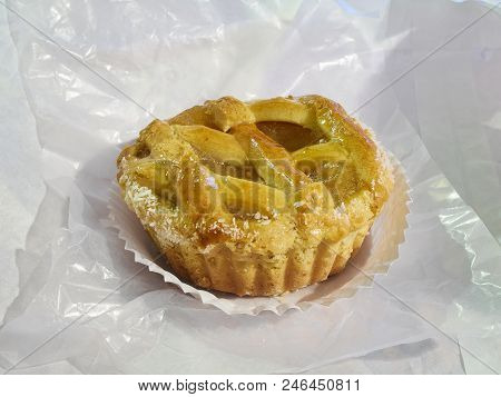 Crostata, Italian Pasta Frolla Quince Jelly Tartlet On A Pastry Paper.