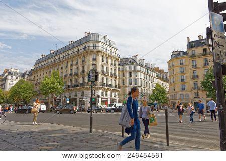 Paris - July 31, 2017: A Woman Walking Down Saint-germain-des-pres In Paris.
