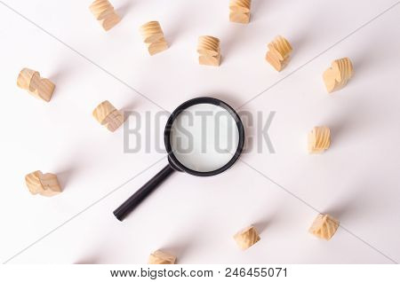 Wooden Figures Of People Lie Around A Magnifying Glass On A White Background. Hiring For Work, Traci