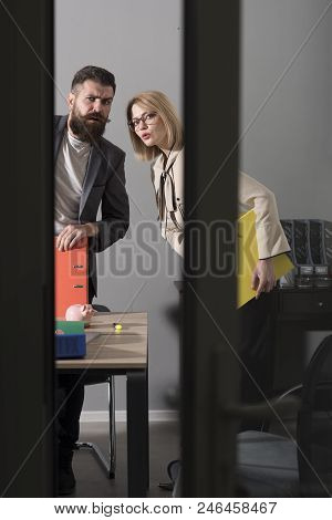 Troubled Business Couple Look Out Modern Office. Colleagues At Meeting In Office With Glass Walls. B