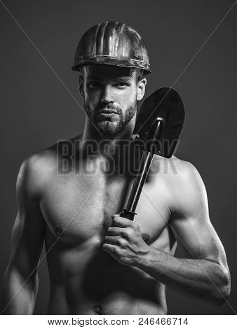 Construction, Heavy Industry, Mining, Occupation, Labour Concept. Muscle Sexy Man With Serious Face
