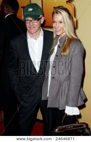 NEW YORK - OCTOBER 24: Woody Johnson and Suzanne Ircha attend the premiere of