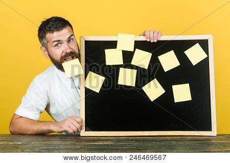 Notes. Business, Planning, Management, Reminder. People Concept. Smiling Bearded Man Holds Board Wit