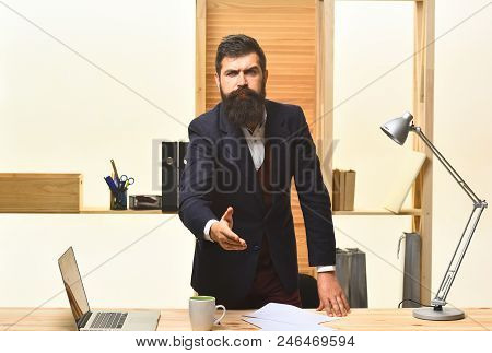 Serious Businessman Welcoming. Handshaking. Portrait Of Considerable Bearded Businessman. Serious Bu
