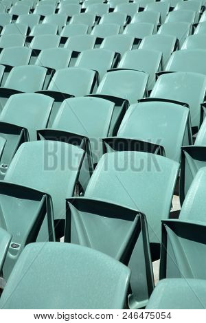 Close up of front of a green arena seats