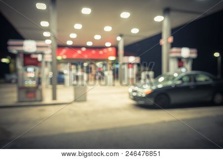Vintage Blurred Gas Station With Car Refueling At Night