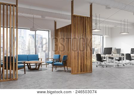Loft Windows Office Waiting Room Interior With A Blue Couch And Armchairs Near A Coffee Table Standi