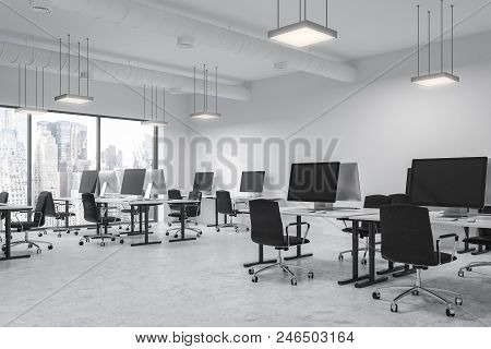 Modern Open Space Office Interior With White Walls And Floor, Rows Of Computer Tables And Panoramic