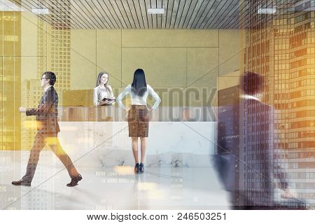 Business People In A Yellow Wall Office Waiting Room Interior With A Marble Floor, And A White Marbl