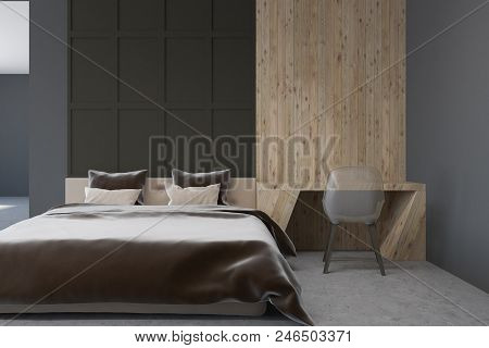 Dark Gray And Wooden Bedroom Interior With A Concrete Floor, A Double Bed And A Home Office. Concept