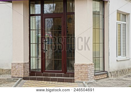 Glass Closed Door On The Facade Of A Modern Building