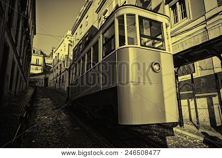 Ancient And Old Lisbon Tram, Detail Of An Ancient Means Of Transportation Around The City, Monument