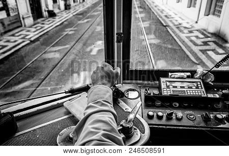 Driver Tram In Lisbon, Detail Of A Person Wearing An Old Tram Travelers In Portugal