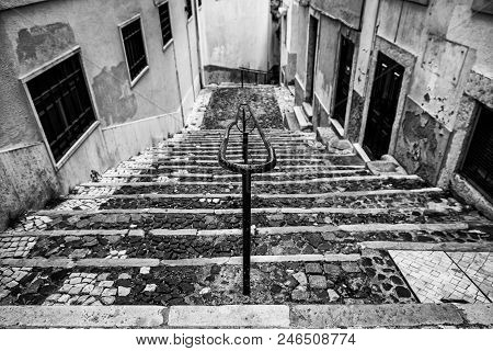 Old Stone Stairs In Lisbon, Detail Of Stairs In An Old Street In An Old Neighborhood In Portugal