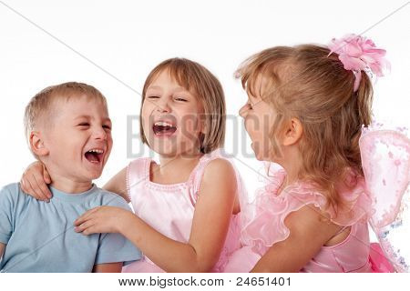Three children joyfully laughing, studio, light background
