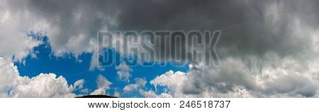 Amazing Cloud Formations On A Dark Blue Sky. Beautiful Side Lit Cloudscape Panorama In Summer