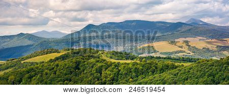 Panorama Of Beautiful Carpathian Countryside. Power Lines Run Across The Nearest Hill. Pikui And Gos