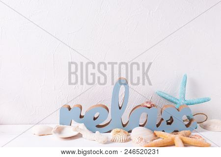 Marine  Decorations And Word Relax On White Textured  Background. Sea Objects. Selective Focus. Plac