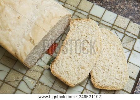 Slice Of Homemade Bread On A Tile