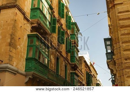 Travel Photo Of The Narrow Streets In The Old City Of Valletta In Malta With Colourful Balconies.