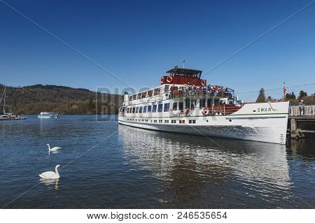 South Lakeland, Uk - April 2018: Bowness Pier With Boats For Hire And Tourist Cruises At Bowness-on-