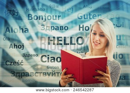 Student Girl Holding A Dictionary And Word Hello Translated In Different Languages On The Background