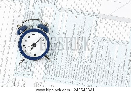 Tax Concept With Alarm Clock On 1040 Tax Form
