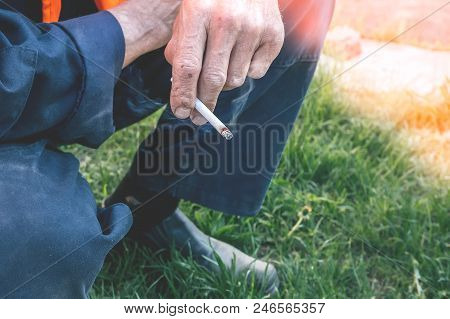 Elective Focus On The Hand Of The Employee Taking A Break Smoking A Cigarette. Fight Against Bad Hab