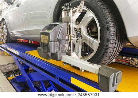 Car Undergo Wheel Align In Garage