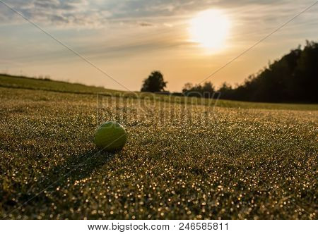 Deatil Of Golf Course With Bals In Sunrise