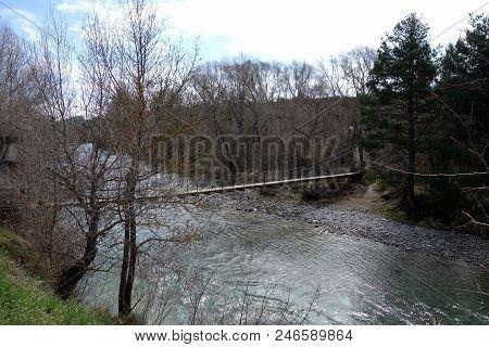 A Suspension Bridge In A Non-urban Scene Day.
