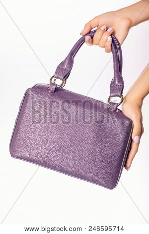 Close Up Photo Of Trendy Violet Bag In Hands Of Fashionable Woman . Fashion Elements
