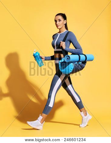 Go To Gym! Attractive Latin Woman In Fashionable Sportswear On Yellow Background. Dynamic Movement.
