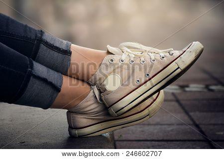 Women Legs. Sneakers On Girl Legs. Sneakers. Sneakers On Legs. Casual Clothing. Girl Wearing Sneaker