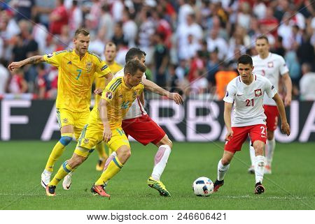 Marseille, France - June 21, 2016: Ukrainian (in Yellow) And Polish Players Fight For A Ball During