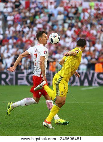 Marseille, France - June 21, 2016: Arkadiusz Milik Of Poland (l) Controls A Ball During Uefa Euro 20