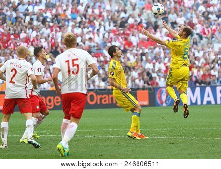 Marseille, France - June 21, 2016: Roman Zozulya Of Ukraine (r) Receives A Ball During The Uefa Euro