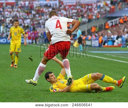 Marseille, France - June 21, 2016: Thiago Cionek Of Poland (l) Fights For A Ball With Taras Stepanen