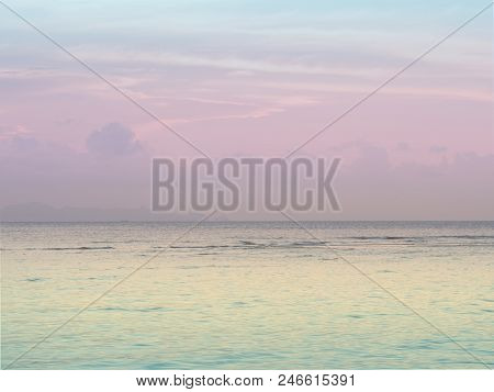Pastel Peaceful Scene Of A Calm Ocean Sea And Sunset Sky.