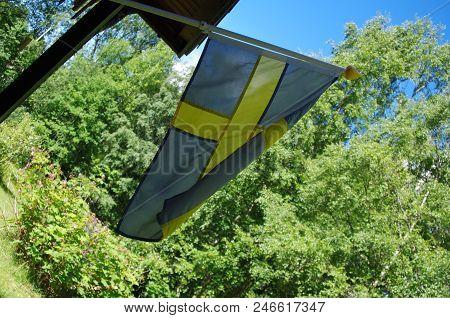 Swedish Flag On A Windy Day In Dalarna