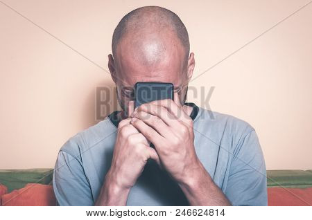 Sad Man Holding His Cell Phone In His Hands And Cry Because His Girlfriend Break Up With Him Over Th