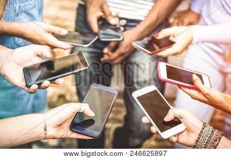 Friends Group Having Addicted Fun Together Using Smartphones - Hands Detail Sharing Content On Socia