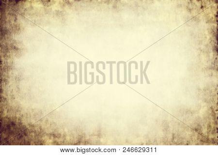 Grunge beige sepia nostalgia graphic parchment edge vignette empty background poster