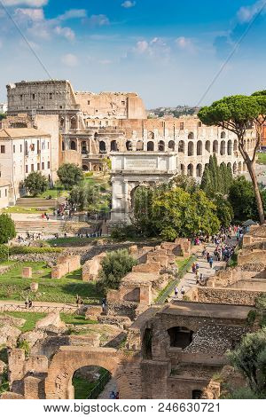 Ancient Arch Of Titus On The Roman Forum Against Colosseum, Rome, Italy, Europe
