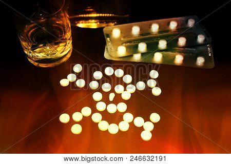 Benzodiazepines Skull Or Other Pills And Glass Of Alcohol, Illustrative Photo, Dangerous Of Overdose