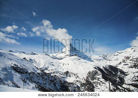 The Famous Mountain Matterhorn Peak With Cloudy And Blue Sky From Gornergrat, Zermatt, Switzerland